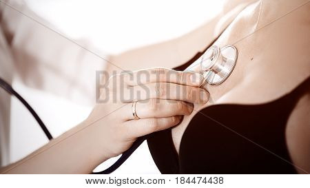 Female Medicine Doctor Holding Stethoscope To Pregnant Woman Standing For Encouragement, Empathy, Ch