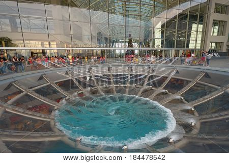 SINGAPORE - CIRCA NOVEMBER, 2015: water at  Rain Oculus falling through the atrium. Rain Oculus is a large whirlpool forms inside a 70 foot diameter acrylic bowl and falls 2 stories to a pool below