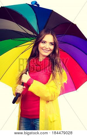 Woman In Rainproof Coat Under Umbrella