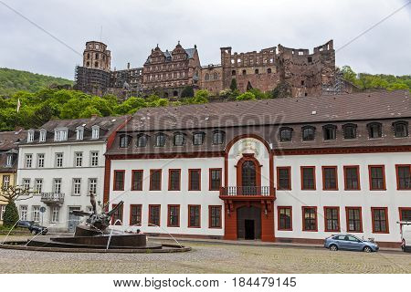 Karlsplatz square in Heidelberg old town Germany. Heidelberg castle on the background