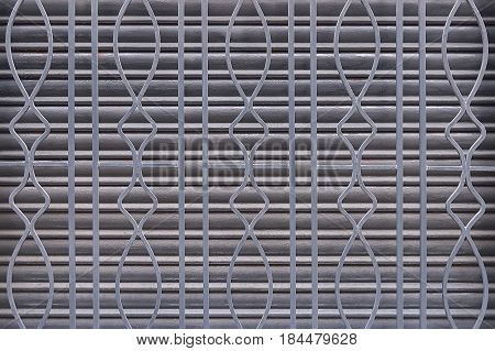 Old iron grating background texture close up