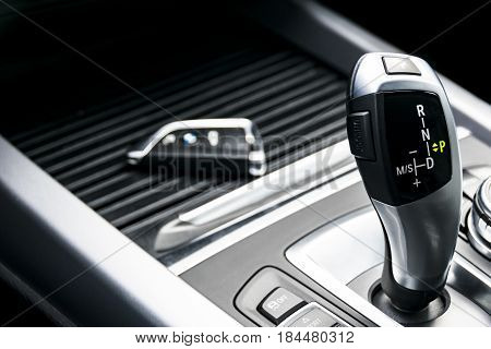 automatic gear stick of a modern car car interior details