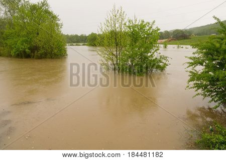 Streams overflow their banks caused by days of rain in Oak Ridge Tennessee
