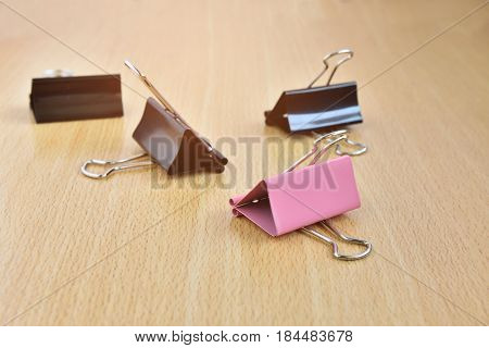 Paper clips on wood desk in office use for documents files.