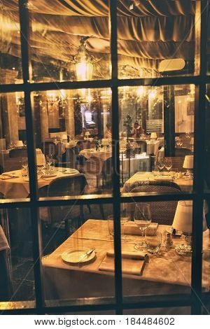 Feb. 17, 2017 - Romantic view over glass of the interior of a small restaurant in the heart of Venice, Italy 17, 2017