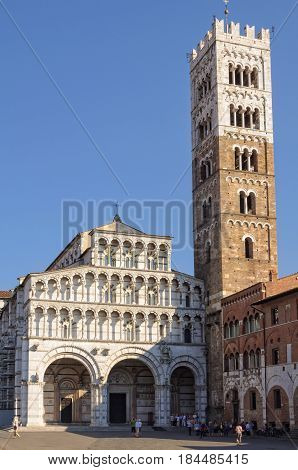 The facade, with its vast portico of three magnificent arches and three ranges of open galleries, and the bell tower of Lucca Cathedral in Italy - 29 September 2011