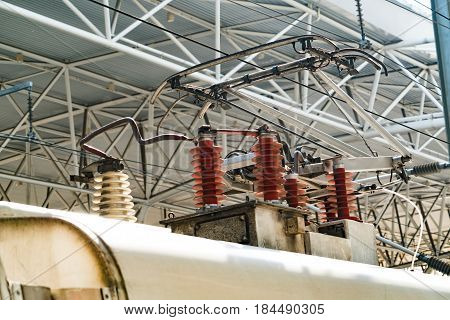 Electric train trolley pole. high speed railway electrification system. Overhead cable wire over rail track. Power lines.