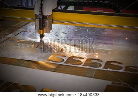 The CNC laser cut machine while cutting the sheet metal with the sparking light .The hi-precision sheet cutting process by laser cut