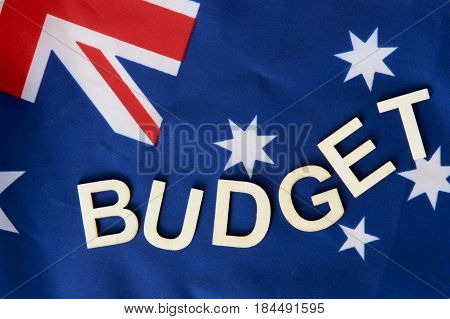 Australian flag with budget signage written with letters.