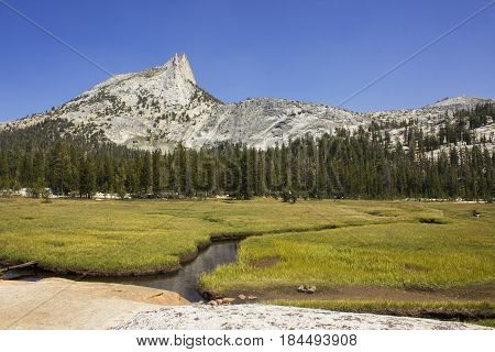 Cathedral Peak as seen from Cathedral Lake in Tuolumne Meadows, Yosemite National Park.