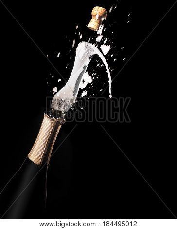 Champagne Bottle And Spray On Black Backgroun