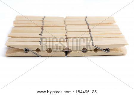 Wood Clothespegs On White Background