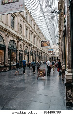 Brussels Belgium - July 30 2016: The Royal Galerie of St Hubert is a glazed shopping arcade in Brussels. It is home to lots of luxury boutiques clockmakers and chocolate shops.