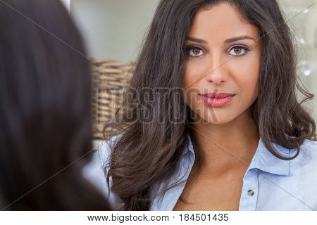 Portrait of a beautiful thoughtful young Latina Hispanic woman with a friend