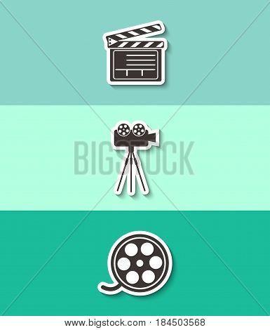 Movie clapper boards, film reel and cinema camera vector icon. Three flat design icons.