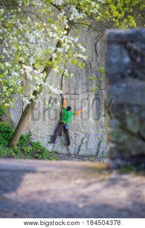 Climber Climbs On The Rock.
