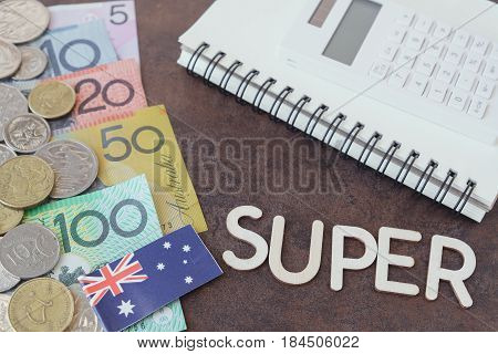 Australian money AUD with SUPER word calculator and notebook