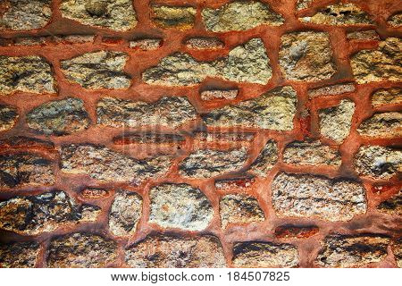 The sample of granite masonry with red mortar wall Topkapi Palace Istanbul Turkey stonework interlayer