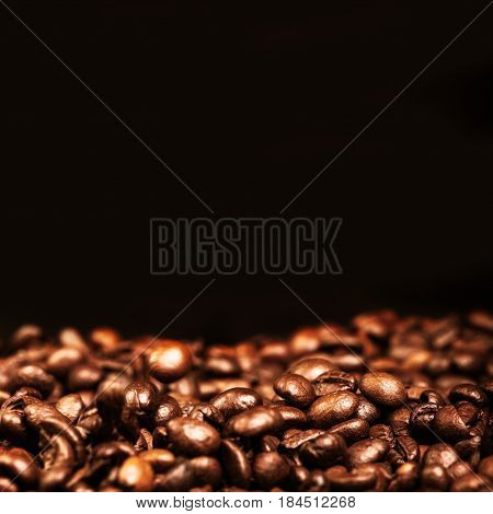 Coffee Beans Caffeine Roasted Brown Espresso wall paper with black copyspace close up. Fried Coffee Beans Texture macro