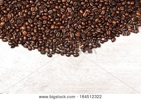 Coffee beans background macro. Dark Roasted coffee beans textured wallpaper for your design with copy space