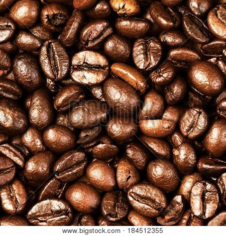 Coffee Beans Caffeine Roasted Brown Espresso wall paper close up. Fried Coffee Beans Texture macro