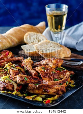 Roasted Sliced Barbecue Pork Ribs, Seasoned With A Spicy Basting Sauce And Served With Vegetables.