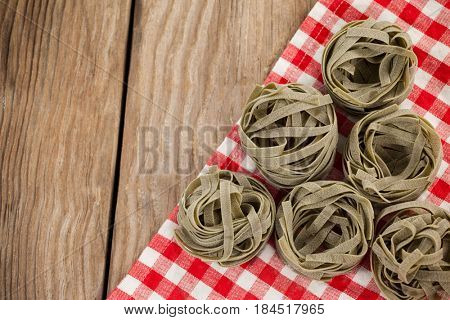Close-up of fettuccine pasta on table cloth