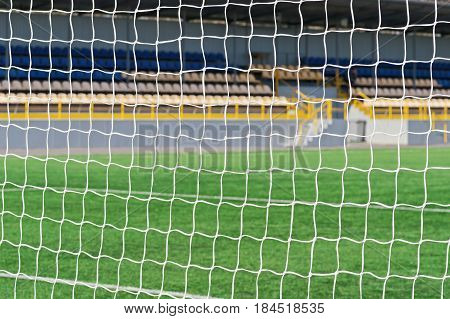 Football Net Background Over Soccer Field Stadium