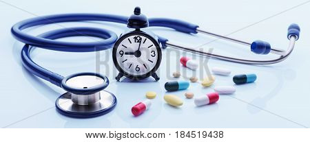 Time for health checkup with stethoscope and medicine on blue background