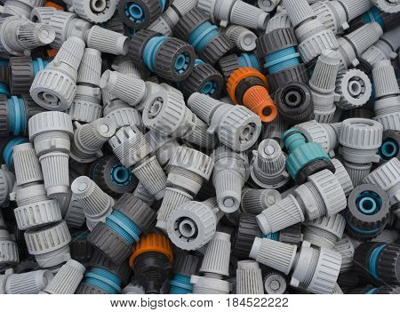 A selection of old and dusty garden hose connectors and spray nozzles