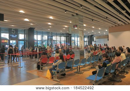 TAICHUNG TAIWAN - DECEMBER 11, 2016: Unidentified people travel at Taichung long distance bus terminal
