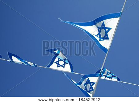 Pennants with Israeli symbols on the blue sky background