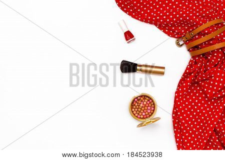 red dress makeup brush nail Polish on a white background. Feminine minimal concept. Flat lay. Top view.