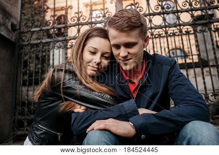 A student couple in love sharing a quiet moment outside school