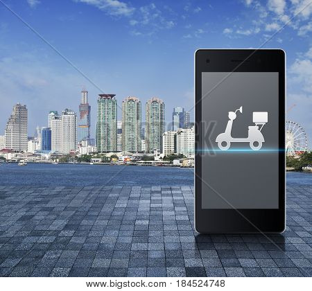 Motor bike on modern smart phone screen on on stone tile floor over modern city tower river and blue sky Business delivery service concept