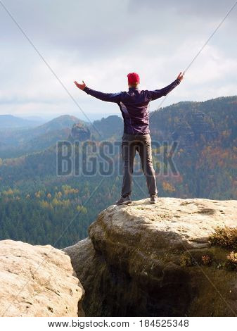 Alone Hiker In Red Cap Stand On The Peak Of Sandstone Rock In Rock Empires Park And Watch