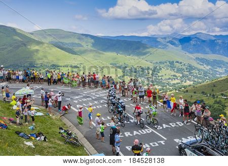 Col de PeyresourdeFrance- July 23 2014: Group of cyclists climbing the road to Col de Peyresourde in Pyrenees Mountains during the stage 17 of Le Tour de France on 23 July 2014.