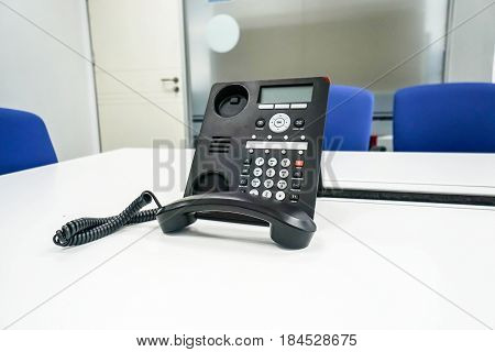 IP voip phone in modern boardroom for management meeting