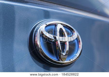 Frankfurt Germany - March 30 2017: Logo of a Toyota hybrid car