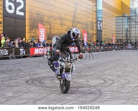 St. Petersburg Russia - 15 April, Front wheel braking,15 April, 2017. International Motor Show IMIS-2017 in Expoforurum. Sports motorcycle show of bikers on the open area.