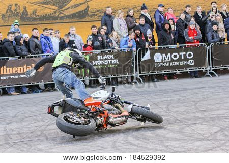 St. Petersburg Russia - 15 April, The biker drops the motorcycle,15 April, 2017. International Motor Show IMIS-2017 in Expoforurum. Sports motorcycle show of bikers on the open area.