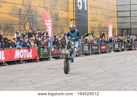 St. Petersburg Russia - 15 April, A trick in front of spectators on the rear wheel,15 April, 2017. International Motor Show IMIS-2017 in Expoforurum. Sports motorcycle show of bikers on the open area.