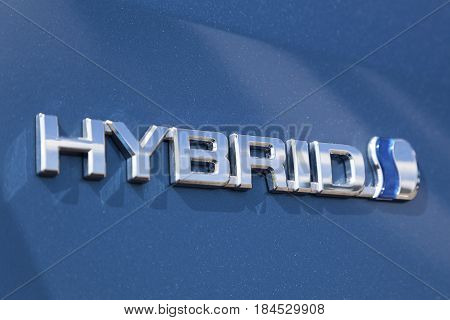 Frankfurt Germany - March 30 2017: Logo of a Toyota hybrid car. Toyota is the world's leader in sales of hybrid vehicles.