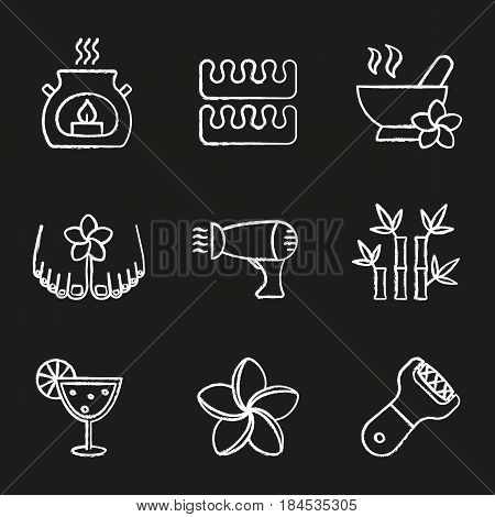 Spa salon chalk icons set. Aromatherapy candle, toes separators, mortar and pestle, hairdryer, plumeria, bamboo sticks, cocktail, foot file. Isolated vector chalkboard illustrations
