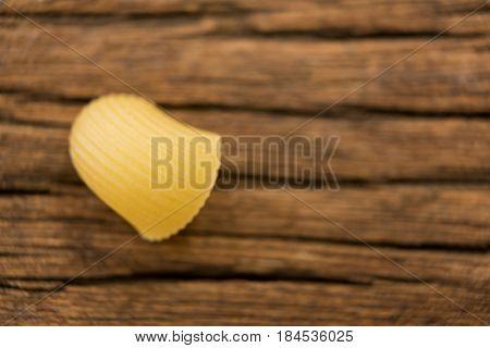 Lumache rigate pasta isolated on wooden surface
