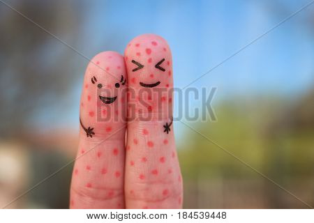 Fingers art of couple with problem skin.