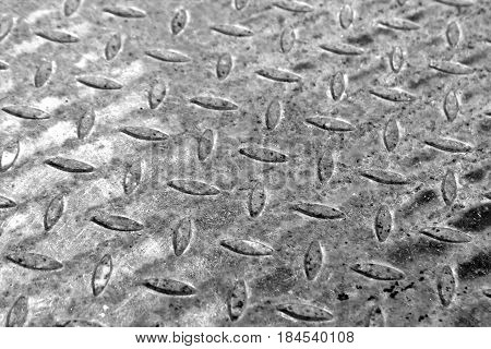 Close-up Of Rusty Metal Floor Pattern With Blur Effect.