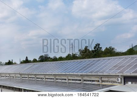 Commercial Solar System placed on a rooftop of industrial building helping lowering electricity bills.