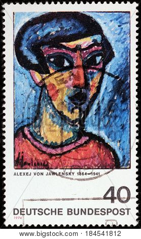 LUGA RUSSIA - APRIL 26 2017: A stamp printed by GERMANY shows painting Head in Blue by Alexej von Jawlensky - famous Russian expressionist painter active in Germany circa 1974