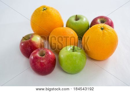 Close-up of oranges, red apples and green apples o white background